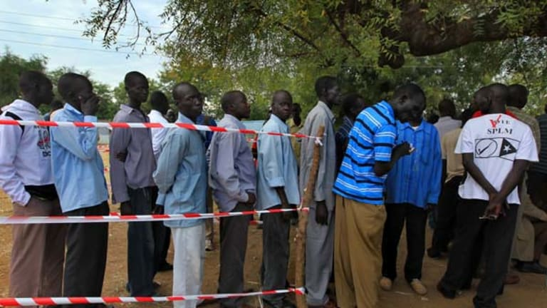 South Sudanese queue under a tree in the streets of Juba to register to vote in the upcoming referendum for independence.