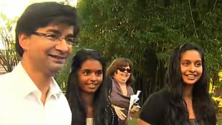 A smiling Lloyd Rayney is reunited with his daughters Caitlyn (centre) and Sarah (right).