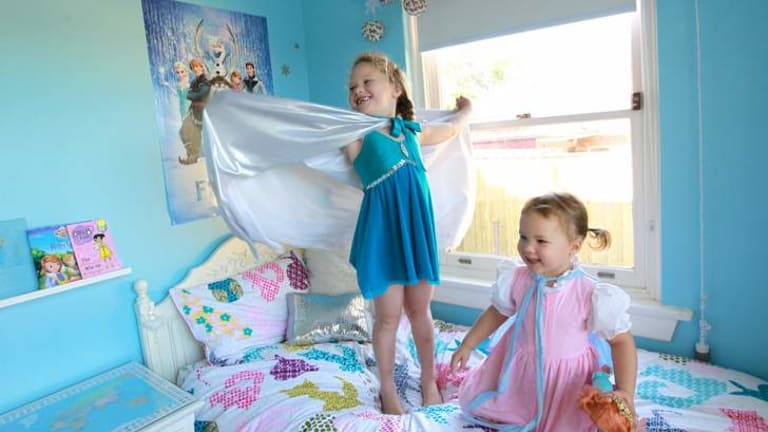 In their element: Tahlia Crewe, 6, and her younger sister, Mikayla, 3, are obsessed with the movie and had to make their own costumes.