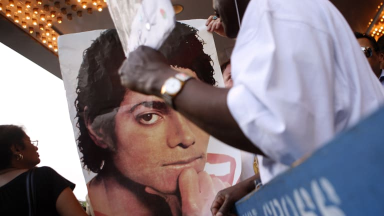 A poster of Michael Jackson is displayed outside Harlem's Apollo theatre.