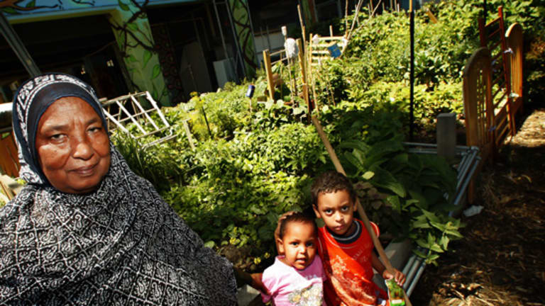 Sadeia Idris Aman with grandchildren Mariem and Mohammed at the Atherton Community Garden in the Collingwood Public Housing Estate.