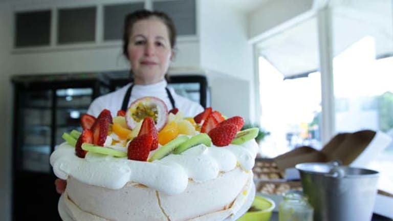 Sweet temptation ... Noga Maman, of Noga's Cuisine at Bondi, with a pavlova, which the Oxford English Dictionary has declared to be from New Zealand.
