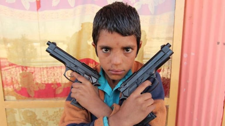 Steel, the young (perhaps 10-year-old) leader of a street gang in Jalalabad, Afghanistan, in George Gittoes' documentary <i>Snow Monkey</i>.