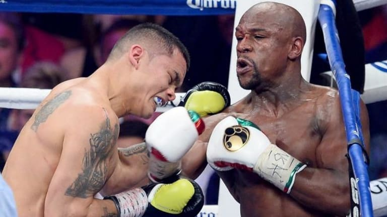 Floyd Mayweather throws a right-hander to the face of Argentinean opponent Marcos Maidana at the MGM Grand Garden Arena in Las Vegas.