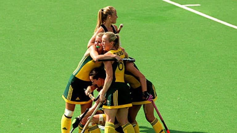 The Hockeyroos celebrate after Ashleigh Nelson's late goal in the women's final. The Hockeyroos won in a penalty shootout.