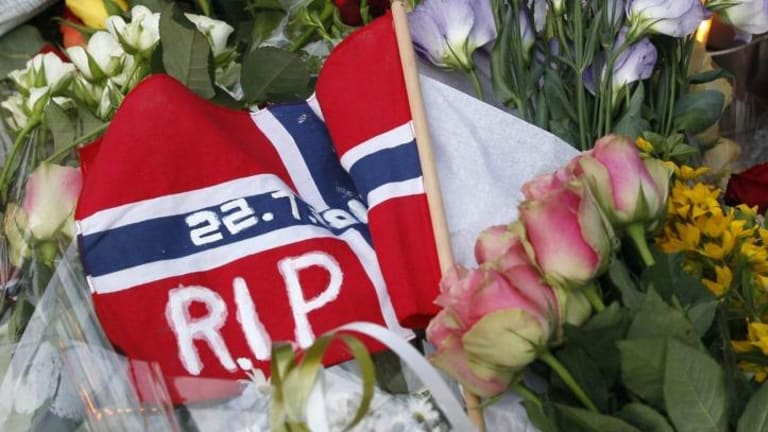 Mourning: Flowers and a flag for the victims of the shooting spree and bomb attack in 2011.