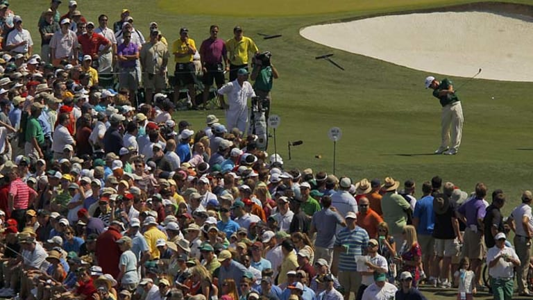 Louis Oosthuizen of South Africa hits his tee shot on the third hole.
