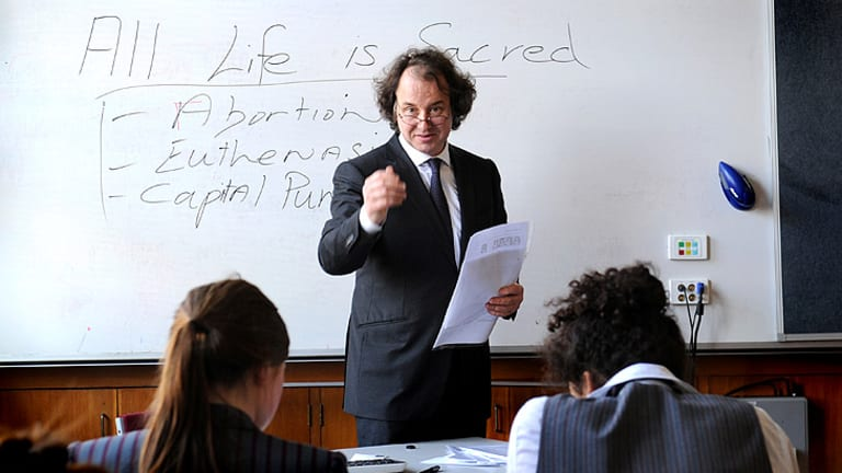 From stump to school: Julian McGauran lectures a year 11 class on public speaking.
