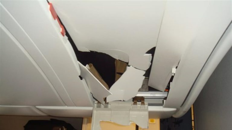 Roof damage in the A330's cabin: 'It just looked like the Incredible Hulk had gone through there in a rage and ripped the place apart,' Kevin Sullivan recalls.