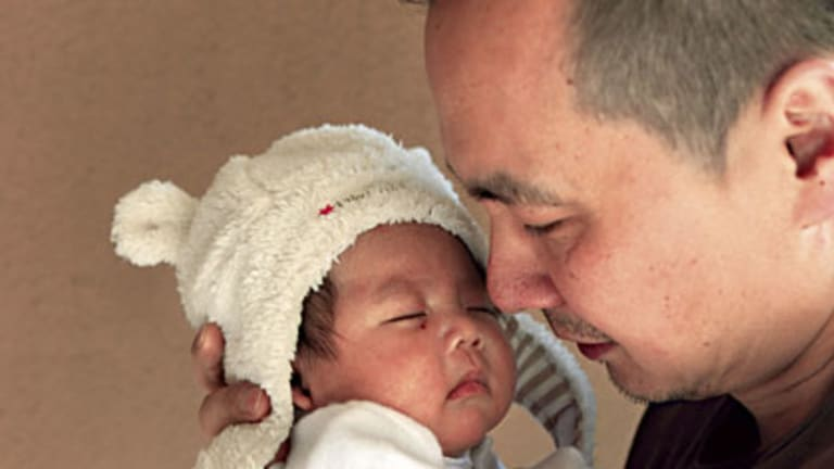 Devastated ... Jason Zheng with son Alexander.