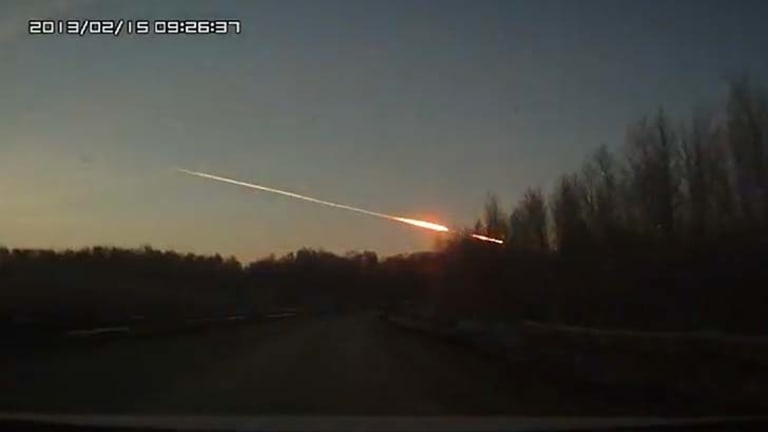 Flames shoot across the sky after at least one meteor hit the ground.