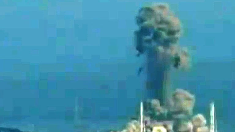 A screen grab from local news footage shows the blast at the Fukushima nuclear power station.