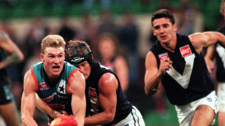 Nathan Buckley being tackled by Nathan Burke while playing for the Allies in 1996.