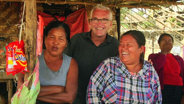 On the move: Bob Percival, who is a walking tour guide in Yangon.