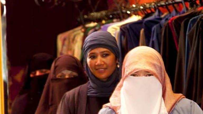 From front to back: Rachel Woodlock, Shanaaz Copeland, Nejla Selbibeg and Saiqa Perveen in Sydney Road, Brunswick.