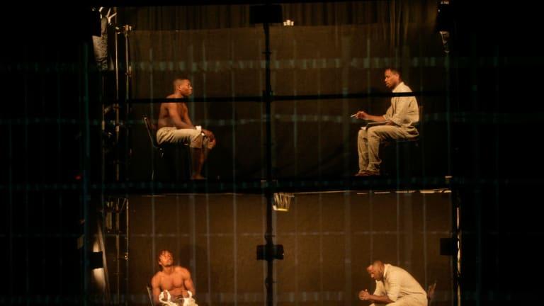 Mandela, played by Perci Moeketsi, top right, in jail in Madiba.