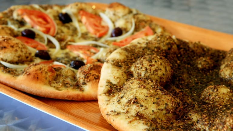 Topping the list: Manoosh Lebanese Pizzeria in Enmore, NSW, was voted the favourite restaurant of Menulog customers.