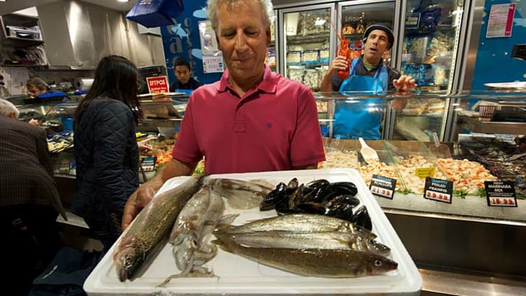 Commercial fisherman John Manias displays sustainable seafood including trout, calamari and mussels  at the Queen Victoria Market.