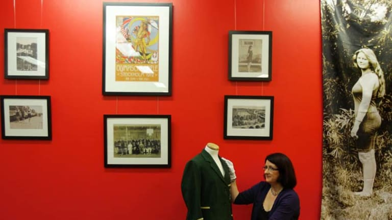 Water life ... Georgina Keep with an Olympic blazer and other items from the Mina Wylie exhibition at the Bowen Library, Maroubra.