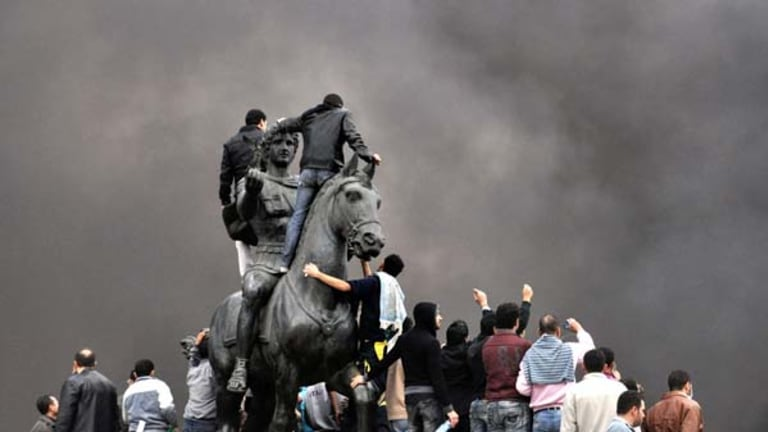 Angry scenes ... protesters gather at the statue of Alexander the Great in Cairo to demand the resignation of Hosni Mubarak