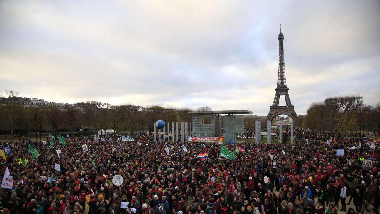 Activists gather near the Eiffel Tower.