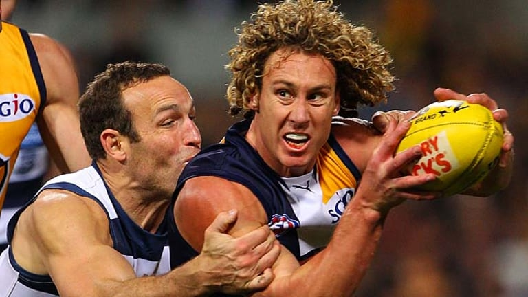 Brad Ottens tackles Matt Priddis of the Eagles.