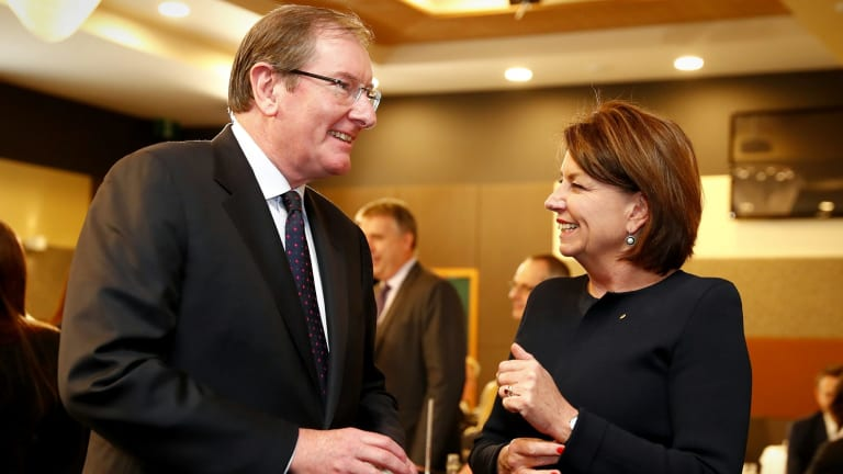 Brian Loughnane, former federal director of the Liberal Party, speaks with Anna Bligh, after her address to the National Press Club.