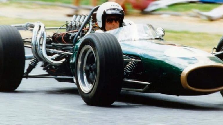 Sir Jack Brabham exits a corner in a Repco Brabham 1966 at Albert Park in 1994.