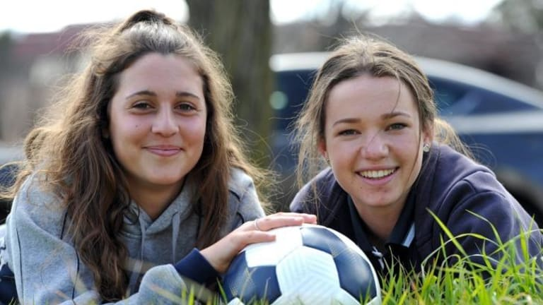 Grace Maher, 15, right, and Julia De Angelis, 16, are the two new additions to the Canberra United squad.