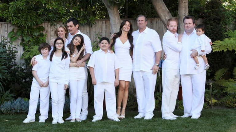 Booked their tickets for Australia ... The cast of American sitcom Modern Family, starring Jesse Tyler and Eric Stonestreet (far right).