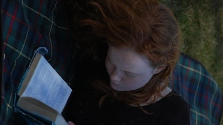 Liv Hewson deep in a book during her childhood in Canberra. Words, stories, language have always been important to her.