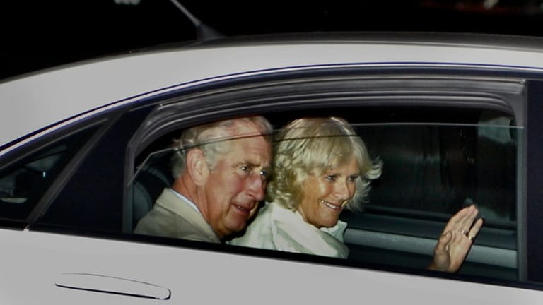 A smile and a wave from the royal couple after their arrival in Melbourne last night.