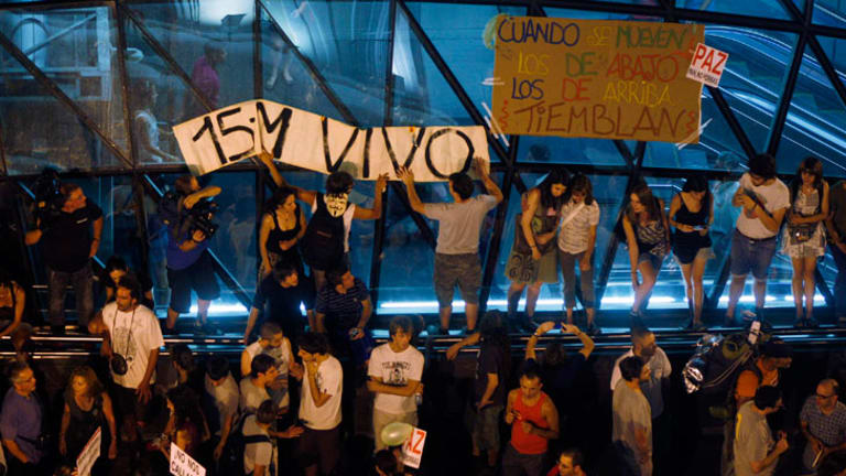 Youths demonstrate against political leaders' handling of jobs crisis in Spain, where the youth unemployment rate has risen to more than 50 per cent.