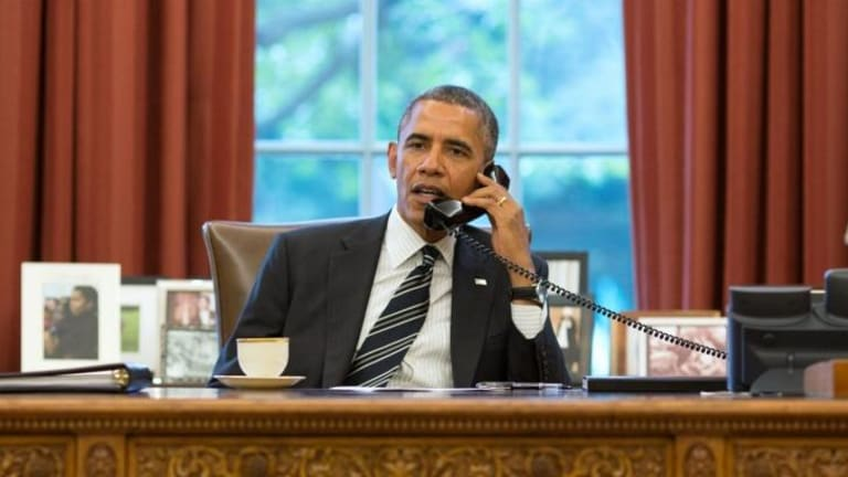 Rare talks: US President Barack Obama speaks with his counterpart Hassan Rouhani for the first time in 2013.