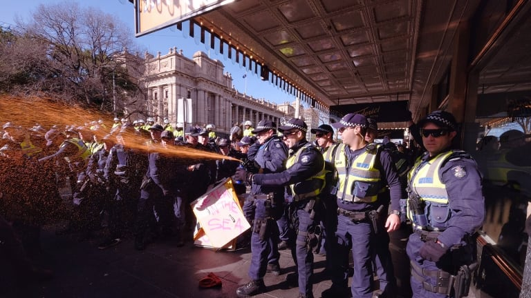 Police use pepper spray at the protest in Melbourne.
