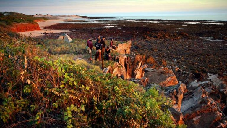 Walkers on  the Lurujarri Heritage Trail on the Dampier Peninsular north of Broome, where activities include making clap sticks and boomerangs.