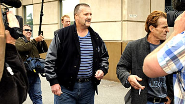 Mark 'Chopper' Read leaves Richmond police station today.