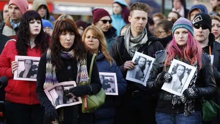 People hold photographs of 17-year-old Rehtaeh Parsons during a memorial vigil at Victoria Park in Halifax, Nova Scotia April 11, 2013.