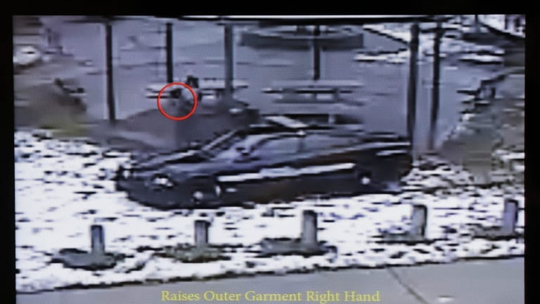 This still image taken from a surveillance video played at a news conference held by Cleveland Police shows police officers arriving at Cudell Park seconds before shooting Tamir Rice.