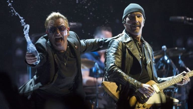 Over the edge: U2 stars Bono and The Edge.