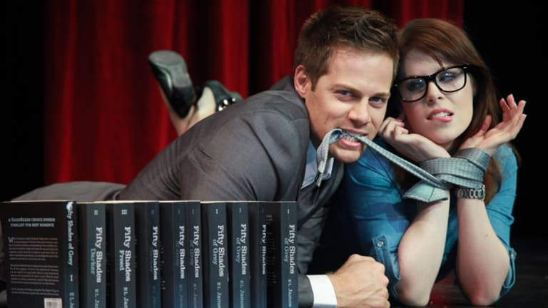 """Stephen Mahy and Caitlin Berry get their """"feelings"""" tied up in knots in """"Spank! The Fifty Shades Parody Musical"""", playing at the Twelfth Night Theatre."""