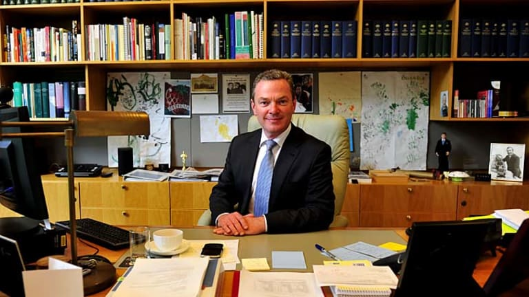 Feet under the desk: Education Minister Christopher Pyne, in his Parliament House office on Friday, will take a hands-on approach to his portfolio.