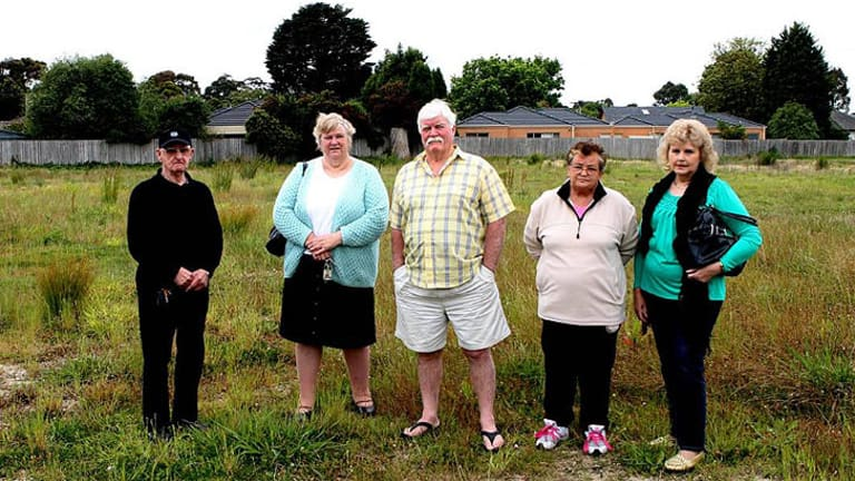 Not welcome ... Doveton residents Noel Johnston, Eileen Lewis, Clive Ritchie, Margaret Monssen and Cynthia Bernardo stand on the site of the proposed mosque.
