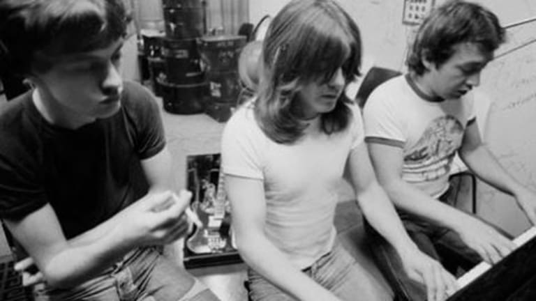 AC/DC producer George Young with brothers Malcolm and Angus.