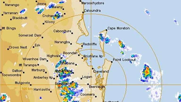 A radar image shows the line of severe storms spreading across southeast Queensland.