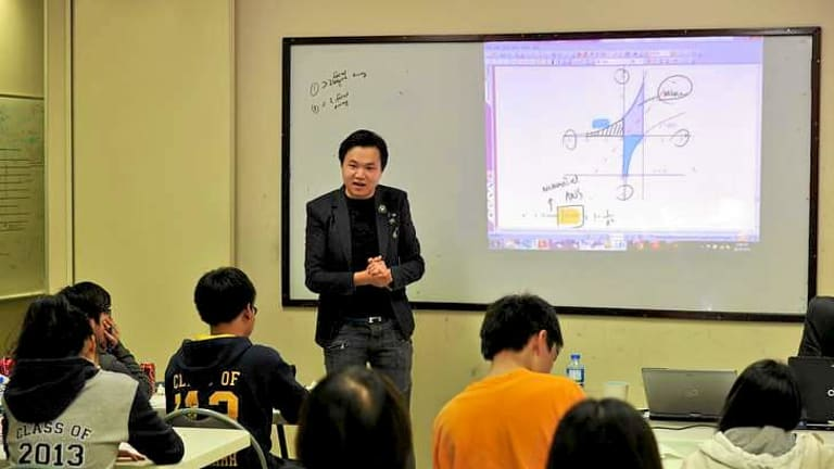 At the private tutoring college Breakthrough Education, in Glen Waverley, teacher Kevin Xiao takes a mathematics class.