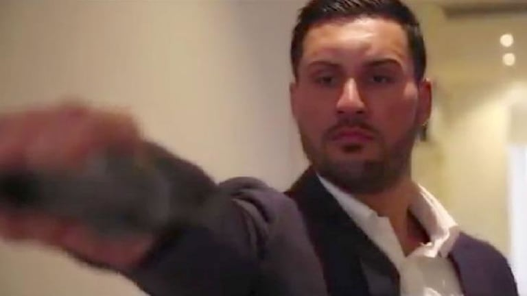 In a dramatic scene from the pre-wedding video, Salim Mehajer is depicted holding and firing a gun.
