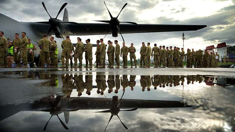Heading home ... The last 50 Australian infantry personnel line up to leave Dili on Friday.