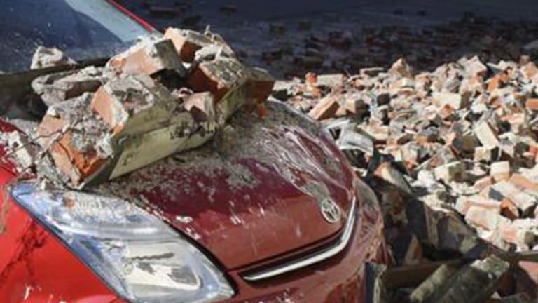 A quake-damaged car is pictured in Christchurch.