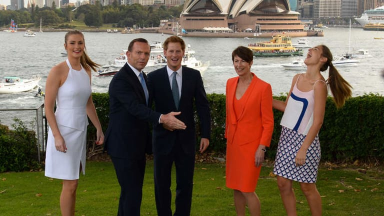 Prime Minister Tony Abbott with Prince Harry, his wife Margie and daughters Bridget, left, and Francis, right at Kirribilli House.